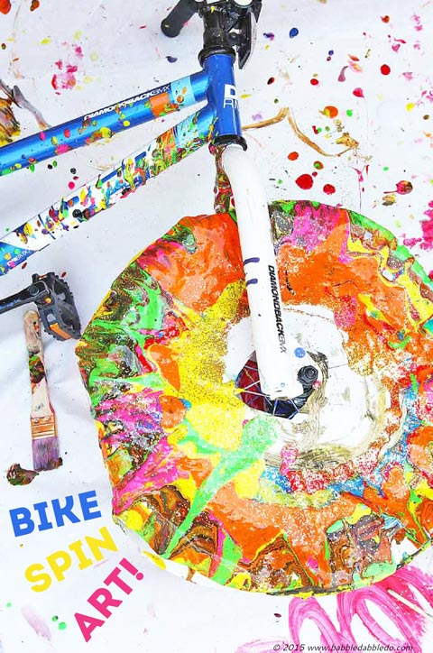 Make Spin Art using a bike tire! Messy and fun process and action art project for kids!