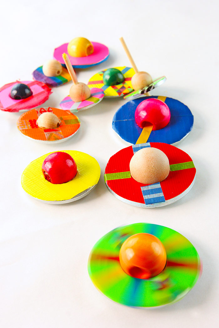 """An easy DIY toy idea that always delights kids and adults is the simple spinning top. This """"spin-finite"""" version is made from two easy to find materials that when combined, spin for a very, very long time!"""