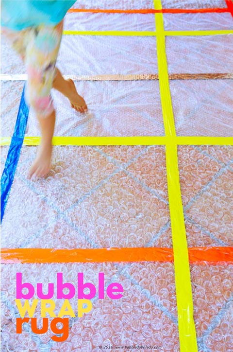Simple craft idea: Turn leftover bubble wrap into a rug for some sensory fun!